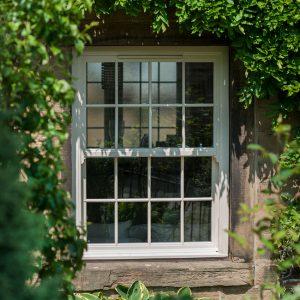 White uPVC sliding sash window - window style