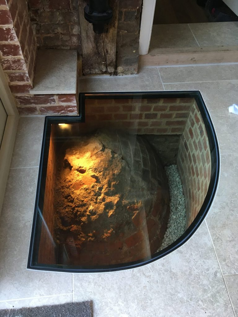 well in home with glass viewing panel